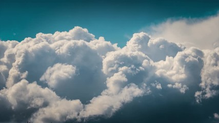 Fotobehang - Epic white cumulus clouds rolling over blue sky background. Timelapse, 4K UHD.