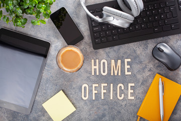 home office text desk with keyboard computer smartphone notebook houseplants, workspace at home