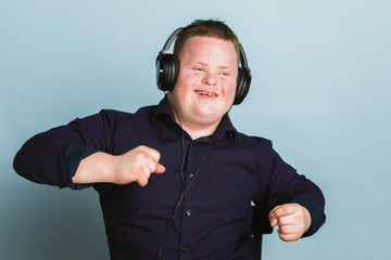 Cool young man with Down Syndrome listening to a sport podcast