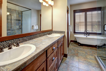 New rustic luxury home bathroom for guest design details with rich wood and grey stone.