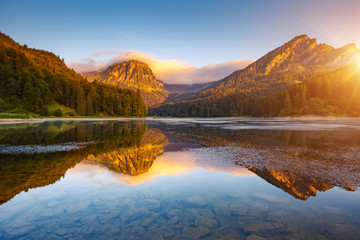 Wall Mural - Morning views of the turquoise Lake Obersee. Location famous resort Nafels, Swiss Alps, Europe.