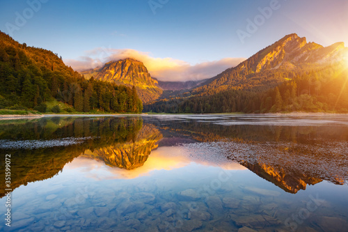 Wall mural Morning views of the turquoise Lake Obersee. Location famous resort Nafels, Swiss Alps, Europe.