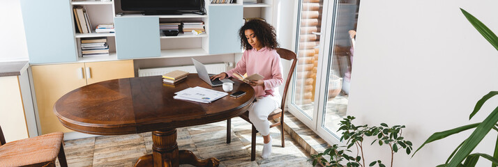 horizontal image of african american freelancer working from home
