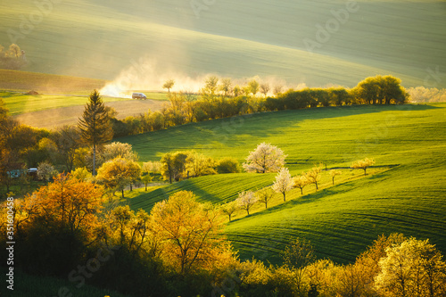 Wall mural Tranquil rural landscape in sunbeams. Location place of South Moravia, Czech Republic, Europe.