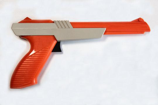 Retro orange and grey light Gun Zapper for arcade or video game console
