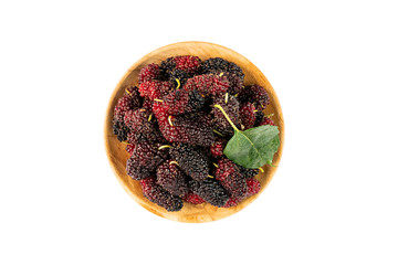 Fototapete - Top view pile of ripe mulberries in a wooden plate on white background with clipping path.