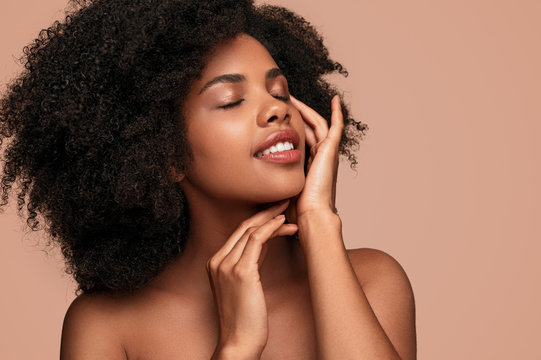 African American woman touching clean skin