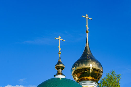 domes of an orthodox temple made of golden metal