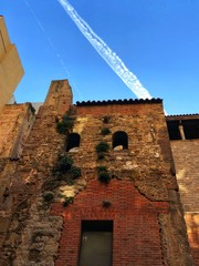 View to wall of old medieval building in gothic block in Barcelona, Spain
