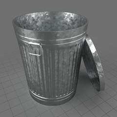 Open metallic trash can