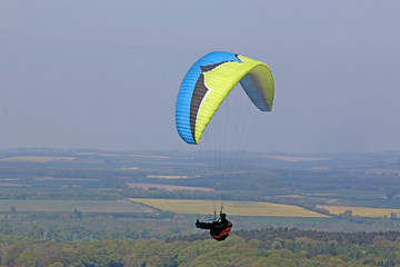 Paraglider flying wing at Milk Hill