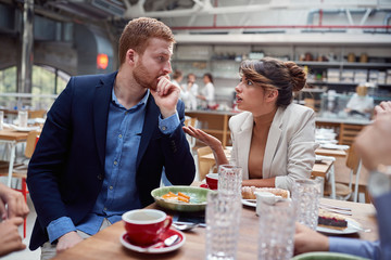 man and woman arguing  at lunch. friends, colleagues, couple, business partners concept