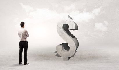 Rear view of a businessman standing in front of $ abbreviation, attention making concept