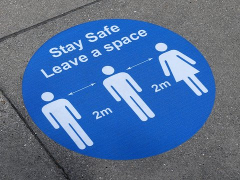 Stay Safe, Leave a space sign on London Underground station platform during the Coronavirus (COVID-19) pandemic