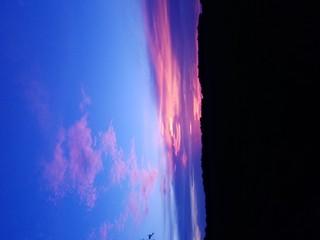 Foto auf AluDibond Dunkelblau Silhouette Landscape Against Blue Sky At Sunset