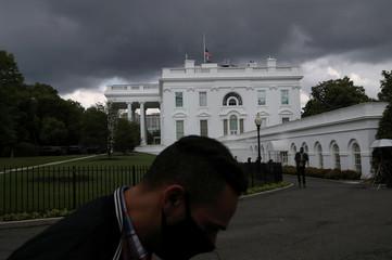 The American flag flies at half-staff over the White House honoring coronavirus (COVID-19) victims in Washington, U.S.