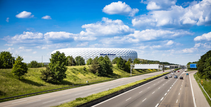 Munich, Germany - May 21, 2020: Viewing to the Allianz Arena Soccer stadium from a bridge over the Motorway (Autobahn) A9 with cars passing by.