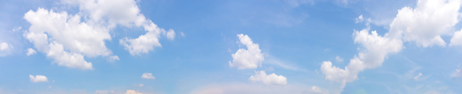 Panorama or panoramic photo of blue sky and white clouds or cloudscape.