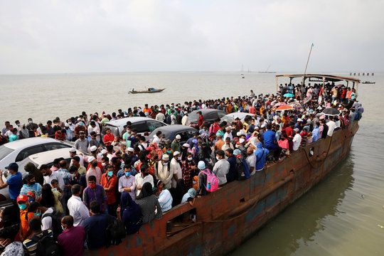Migrant people are seen on board of an overcrowded ferry, as they go home to celebrate Eid al-Fitr amid concerns over the coronavirus disease (COVID-19) outbreak, in Munshiganj