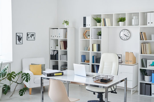 Office of business person with desk, armchair of professional, chair for clients