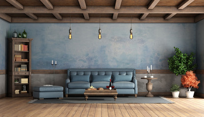 Rustic living room with old walls, blue sofa and wooden ceiling