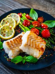 Papiers peints Montagne Fish dish - fried cod fillet with asparagus on wooden table