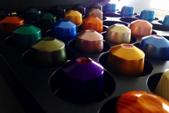 Close-up Of Colorful Nespresso Capsules In Container