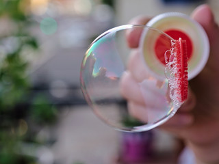 Close view of soap bubble blowing from the wand
