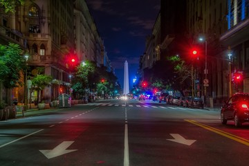 Road Leading Towards Obelisco De Buenos Aires In City At Night