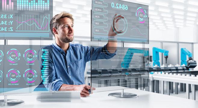 Ingenieur steuert eine moderne Produktionsanlage über verschiedene Touchscreens