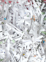 Heap of white shredded papers background, closeup