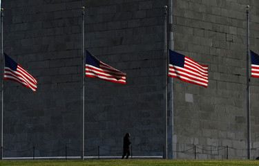 U.S. flags fly at half-staff on the National Mall to commemorate the victims of the coronavirus disease (COVID-19) in Washington