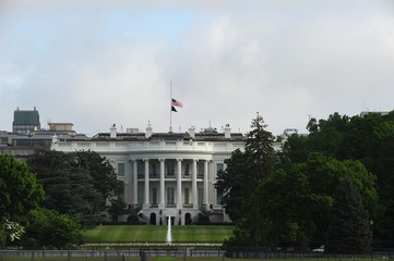 U.S. flag flies at half-staff at the White House to commemorate the victims of the coronavirus disease (COVID-19) in Washington