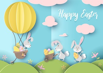 Happy easter greeting card in paper art style vector illustration. Banner with cute rabbits holding eggs on sunny meadow flat design. Spring holiday concept