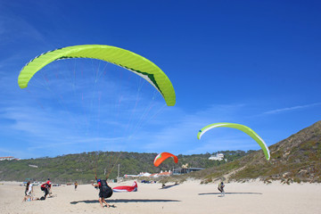 Paragliders ground handling on Victory Walls beach, Portugal