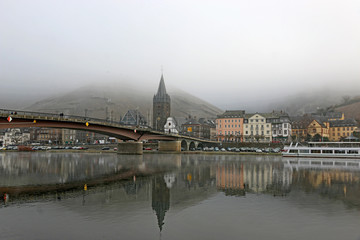 Bernkastel-Kues town reflected in the Moselle in winter
