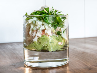 Crab and avocado salad in glass.