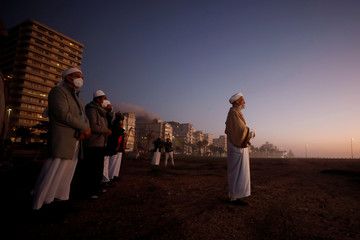 Muslim clerics await the sighting of the moon that marks the end of the holy month of Ramadan during a lockdown aimed at limiting the spread of the coronavirus disease (COVID-19) in Cape Town