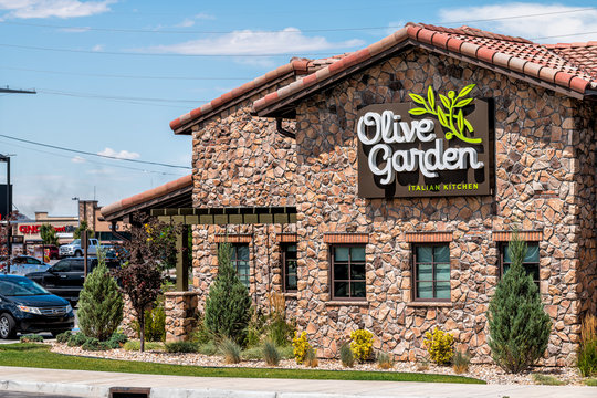 Spanish Fork, USA - July 29, 2019: Olive garden Italian restaurant chain business facade exterior entrance sign and parking lot in Utah