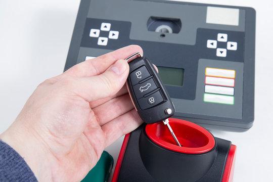 Car keys, manufacturing. Chips, programming. Equipment for making car keys.