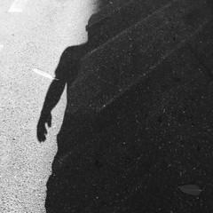 Fototapeta Shadow Of Man On Street During Sunny Day obraz