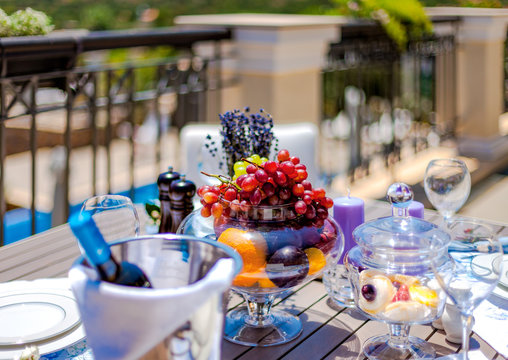table with fruit and wine on the summer terrace