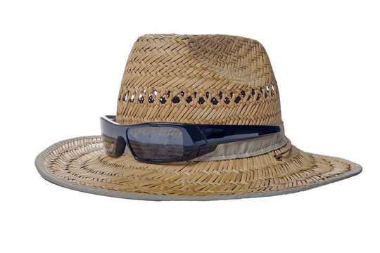 black sunglasses and  straw summer hat on a white  background