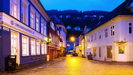 Wall Mural - Bergen, Norway. View of old historical fishermen houses in Bergen, Norway during the sunrise. Time-lapse of empty streets in the morning after the rain