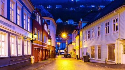 Wall Mural - Bergen, Norway. View of old historical fishermen houses in Bergen, Norway during the sunrise. Time-lapse of empty streets in the morning after the rain, panning video