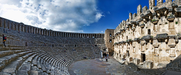 Ancient Roman Amphitheater Against Sky In City