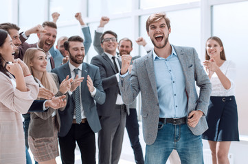 happy business team applauding the leader of a successful projec