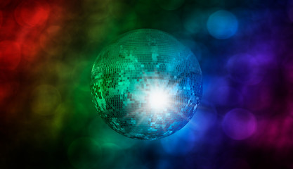 Wall Mural - Party disco mirror ball reflecting purple lights