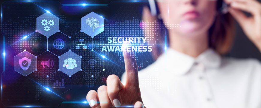 Business, Technology, Internet and network concept. Young girl holding a sign with an inscription Security Awareness.