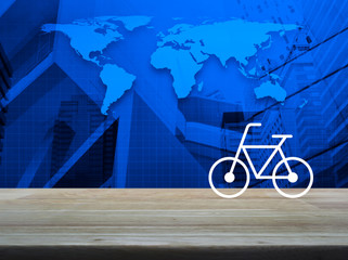 Bicycle flat icon on wooden table over world map, modern city tower and skyscraper, Business bicycle shop online concept, Elements of this image furnished by NASA
